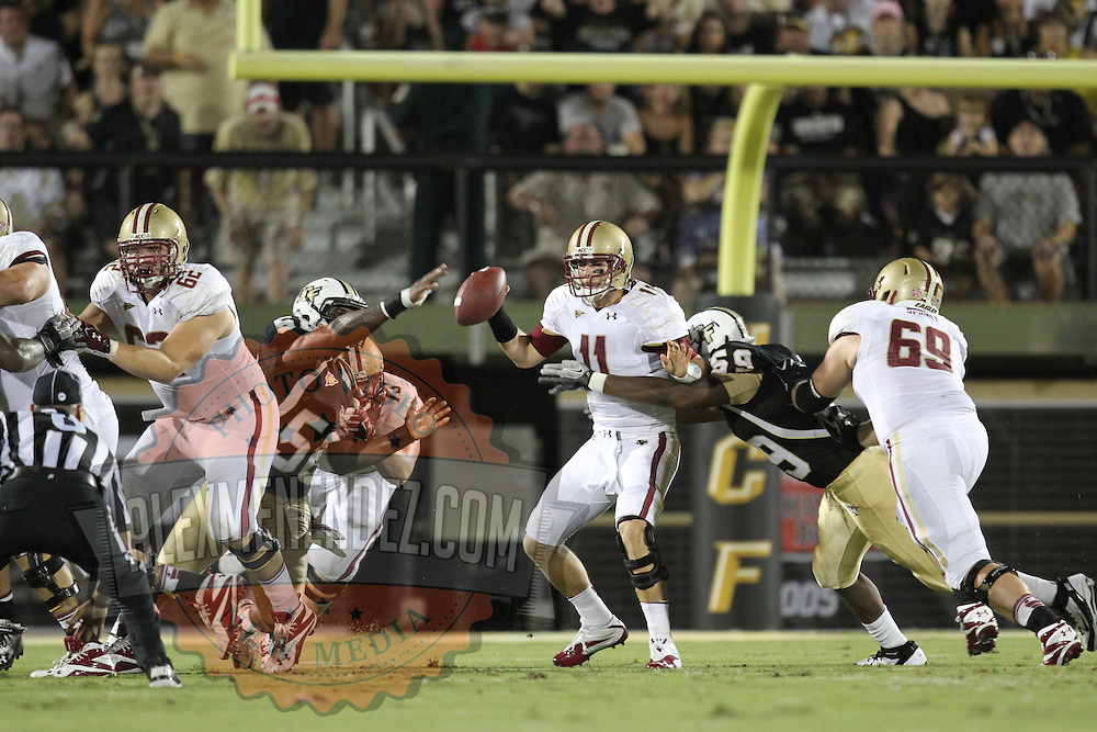 Boston College quarterback Chase Rettig (11) gets sacked by Central Florida defensive end LeBranden Richardson (59) during an NCAA football game between the Boston College Eagles and the UCF Knights at Bright House Networks Stadium on Saturday, September 10, 2011 in Orlando, Florida. (AP Photo/Alex Menendez)