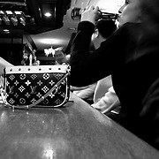 Louis vuitton Bag of a girl in a bar