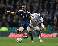 Scotland's Darren Fletcher tussles with England's Wayne Rooney<br /> <br /> - International Friendly - Scotland vs England- Celtic Park - Glasgow - Scotland - 18th November 2014  - Picture David Klein/Sportimage