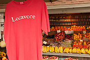 """A hanging T-shirt imprinted with the word """"Locavore"""" at Walker's Roadside Stand, Little Compton, Rhode Island."""