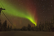 An Auroral band stretching across a road about 20 kilometres to the northwest of Inari in Northern Finland.