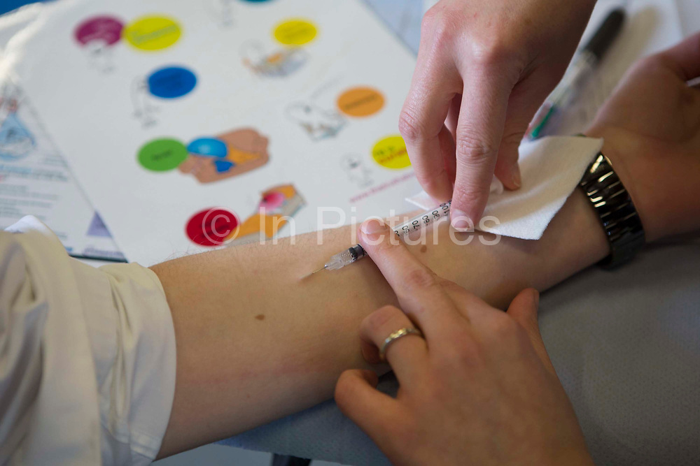 Sarah Murphy, TB Nurse Specialist, performs an intra-dermal injection of the Mantoux PPD skin test on a young person's forearm to screen for Latent TB infection. London, UK.