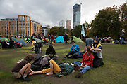 Last remaining tents and activists, two of which are getting a massage at the Extinction Rebellion climate camp at Vauxhall as it is cleared on 15th October 2019 in London, England, United Kingdom. Extinction Rebellion is a climate change group started in 2018 and has gained a huge following of people committed to peaceful protests. These protests are highlighting that the government is not doing enough to avoid catastrophic climate change and to demand the government take radical action to save the planet.