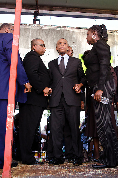 Matt Roth/Novus Select.Thursday, March 22, 2012..Rev. Al Sharpton, middle, stands with Trayvon Martin's mother Sybrina Fulton, right, and other people who spoke at the rally for slain black teen Trayvon Martin at Fort Mellon Park in Sanford, Florida Thursday, March 22, 2012. Trayvon Martin, 17, who was unarmed, carrying only a bag of Skittles and iced tea, was shot after an altercation by neighborhood watch volunteer George Zimmerman, 28, who pursued Trayvon on foot after being told not to by 911 dispatchers. Zimmerman has yet to be arrested because of Florida's controversial Stand Your Ground Law.