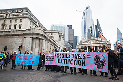 London, UK. 14 October, 2019. Climate activists from Extinction Rebellion block roads around the Bank of England on the eighth day of International Rebellion protests across London.
