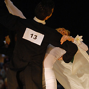 Gergely Darabos, left, of Budapest, Hungary, and Pascal Herrbach, of Berlin, Germany, compete in the adult men's standard A division of the same-sex ballroom dancing competition during the 2007 Eurogames at the Waagnatie hangar in Antwerp, Belgium on July 13, 2007. ..The men won the event championship. ..Over 3,000 LGBT athletes competed in 11 sports, including same-sex dance, during the 11th annual European gay sporting event. Same-sex ballroom is a growing sports that has been happening in Europe for over two decades.