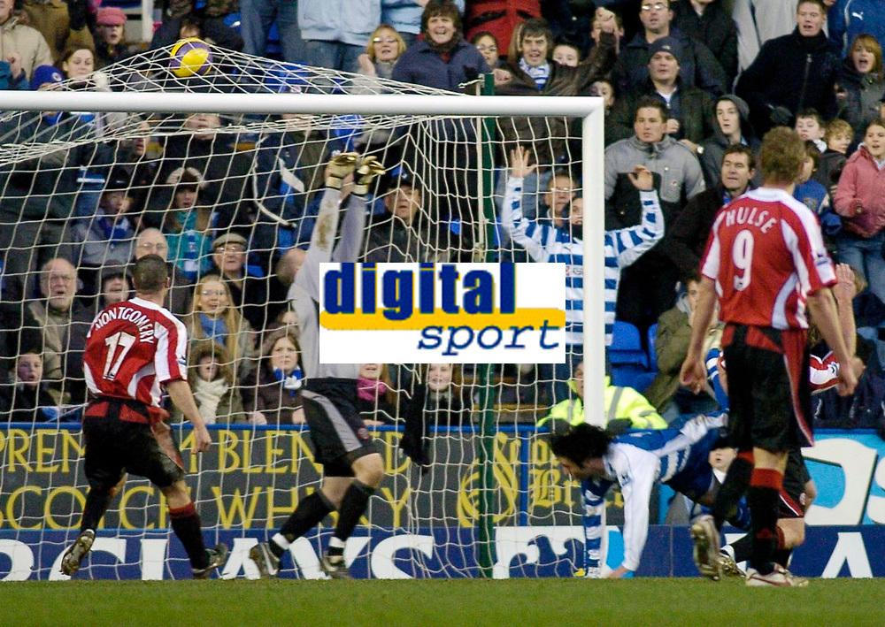 Photo: Gareth Davies.<br />Reading v Sheffield United. The Barclays Premiership. 20/01/2007.<br />Reading's Stephen Hunt (Ground) scores Reading's third goal.
