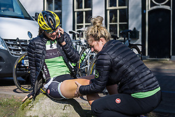 'Yeah, I'm having a massage' Alison Tetrick gets embrocation on a cold day in Dwingeloo  - Drentse 8, a 140km road race starting and finishing in Dwingeloo, on March 13, 2016 in Drenthe, Netherlands.
