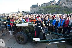 Miss Scotland Jennifer Reochs after firing of the One O'clock gun with Gunner Jamie Shannon..The Miss World participants visit Edinburgh Castle and will witness the firing of the One O'clock gun..MISS WORLD 2011 VISITS SCOTLAND..Pic © Michael Schofield.