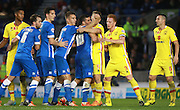 The Brighton attack have a face-off with the MK Dons defence during the Sky Bet Championship match between Brighton and Hove Albion and Milton Keynes Dons at the American Express Community Stadium, Brighton and Hove, England on 7 November 2015. Photo by Bennett Dean.