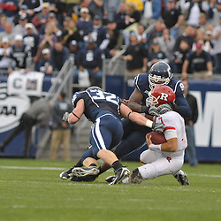 Oct 31, 2009; East Hartford, CT, USA; Connecticut defensive end Lindsey Witten (9) tackles Rutgers quarterback Tom Savage (7) during second half Big East NCAA football action in Rutgers' 28-24 victory over Connecticut at Rentschler Field.