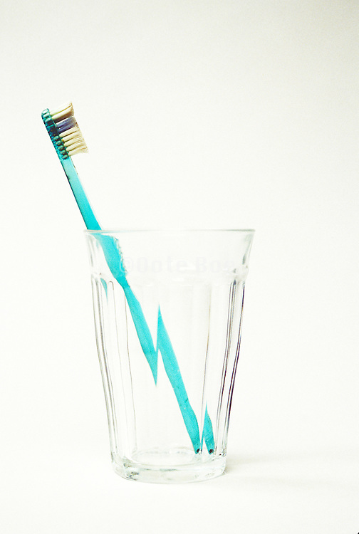 old toothbrush in a glass