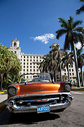 Old Amercian car in excellent condition parked outside the Hotel Nacional / National Hotel, Vedado, Havana, Cuba. .