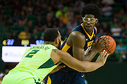 WACO, TX - MARCH 5: Devin Williams #41 of the West Virginia Mountaineers drives to the basket against Rico Gathers #2 of the Baylor Bears on March 5, 2016 at the Ferrell Center in Waco, Texas.  (Photo by Cooper Neill/Getty Images) *** Local Caption *** Devin Williams