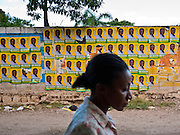 19 NOVEMBER 2010 - PORT-AU-PRINCE, HAITI: A woman walks past campaign posters for Jude Celestin, a candidate for the president of Haiti. Celestin is supported by the Haiti's ruling government and is expected to win the election. PHOTO BY JACK KURTZ