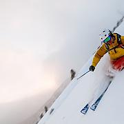 Tanner Flanagan skiing last minute powder at sunset in Grand Teton National Park.