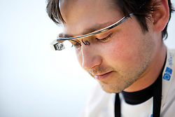 """A Google employee wears a pair of the """"Project Glass"""" during a demonstration at the annual Google I/O developers conference in San Francisco, California."""