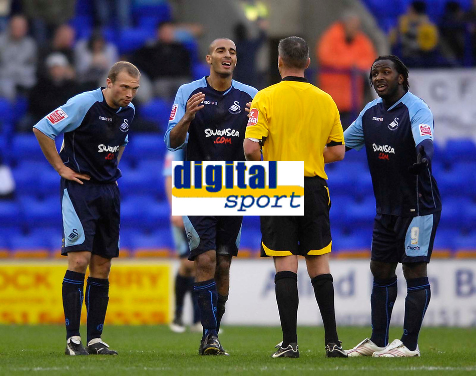 Photo: Jed Wee/Sportsbeat Images.<br /> Tranmere Rovers v Swansea City. Coca Cola League 1. 24/11/2007.<br /> <br /> Swansea's Darren Pratley (C) leads the appeals to referee D Foster.