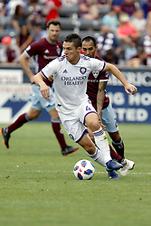 April 29, 2018 - Commerce City, Colorado - Orlando City SC midfielder Will Johnson (4) attempts to keep the ball from Colorado Rapids defender Edgar Castillo (2) in the second half of action in the MLS soccer game between Orlando City SC and the Colorado Rapids at Dick's Sporting Goods Park in Commerce City, Colorado (Credit Image: © Carl Auer via ZUMA Wire)