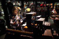 """Alison Abrams of Denver, CO, looks at merchandise in the gift shop at the """"Harry Potter"""" exhibition at Discovery Times in New York. ..Photo by Robert Caplin."""