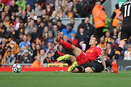 Philippe Coutinho of Liverpool is tackled by Ryan Mason of Hull City. Premier League match, Liverpool v Hull City at the Anfield stadium in Liverpool, Merseyside on Saturday 24th September 2016.<br /> pic by Chris Stading, Andrew Orchard sports photography.