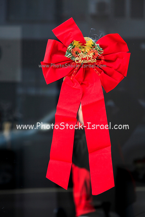 Christmas decoration, red ribbon on a window