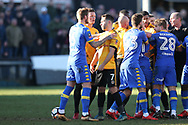 Robbie Willmott of Newport County (7) holds his shirt after he was spat on by Samual Saiz of Leeds Utd (partially hidden in centre) late in the match, leading to all the players getting involved in a scuffle and a red card for Leeds player Samual Saiz for spitting at Willmott. Emirates FA Cup , 3rd round match, Newport county v Leeds Utd at Rodney Parade in Newport, South Wales on Sunday 7th January 2018.<br /> pic by Andrew Orchard,  Andrew Orchard sports photography.