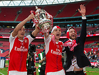 Arsenal's Mesut Ozil (left), Rob Holding (centre), and Shkodran Mustafi (right) celebrate with the trophy     <br /> <br /> <br /> Photographer Craig Mercer/CameraSport<br /> <br /> The Emirates FA Cup Final - Arsenal v Chelsea - Saturday 27th May 2017 - Wembley Stadium - London<br />  <br /> World Copyright © 2017 CameraSport. All rights reserved. 43 Linden Ave. Countesthorpe. Leicester. England. LE8 5PG - Tel: +44 (0) 116 277 4147 - admin@camerasport.com - www.camerasport.com