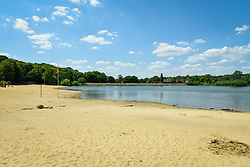 © Licensed to London News Pictures. 01/06/2020. LONDON, UK.  The empty beach at Ruislip Lido in north west London.  Hillingdon Council has closed the beach to the public following several days where the public were not adhering to social distancing as coronavirus pandemic lockdown restrictions have been eased by the UK government.  On the first day of the meteorological summer, visitors who travelled from out of the area resorted to finding a place to sunbathe on any patch of grass they could find.  Photo credit: Stephen Chung/LNP