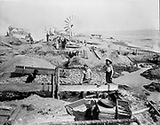 """9707-G05. """"Beach Mining at Nome"""" (caption published in Andrews' The Story of Alaska, 4th edition, opposite pg. 201) Nome, Alaska"""