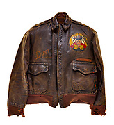 """This type A2 flight jacket was worn by Dale Livingston, a pilot on """"The Baby Buggy"""". The 570th squadron patch is attached to the front of the jacket, and the crews name """"The Baby Buggy"""" is painted above the 8th air force logo on the back of the jacket. Each bomb painted on the jacket signifies a completed mission. Livingston, his crew, and their aircraft received the nickname """"The Baby Buggy"""" due to the average age of their crew, which was less than 21 years old. The crew also completed one of the fastest combat tours, they finished their 35 combat missions in 4 months, from June 1944 to September 1944."""