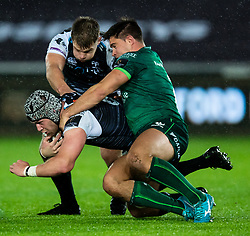 Dan Lydiate of Ospreys is tackled by Dave Heffernan of Connacht<br /> <br /> Photographer Simon King/Replay Images<br /> <br /> Guinness PRO14 Round 6 - Ospreys v Connacht - Saturday 2nd November 2019 - Liberty Stadium - Swansea<br /> <br /> World Copyright © Replay Images . All rights reserved. info@replayimages.co.uk - http://replayimages.co.uk