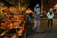 Riley, Logan, Eric and Sheena Natal check out the pallets of pumpkins lining Main Street downtown during Saturday's Pumpkin Fest.  (Karen Bobotas/for the Laconia Daily Sun)