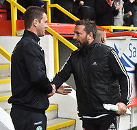 12/09/15 LADBROKES PREMIERSHIP<br /> ABERDEEN v CELTIC <br /> PITTODRIE - ABERDEEN <br /> Celtic manager Ronny Deila (left) with Aberdeen manager Derek McInnes