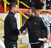 12/09/15 LADBROKES PREMIERSHIP<br /> ABERDEEN v CELTIC <br /> PITTODRIE - ABERDEEN <br /> Celtic manager Ronny Deila (left) with Aberdeen manager Derek McInnes