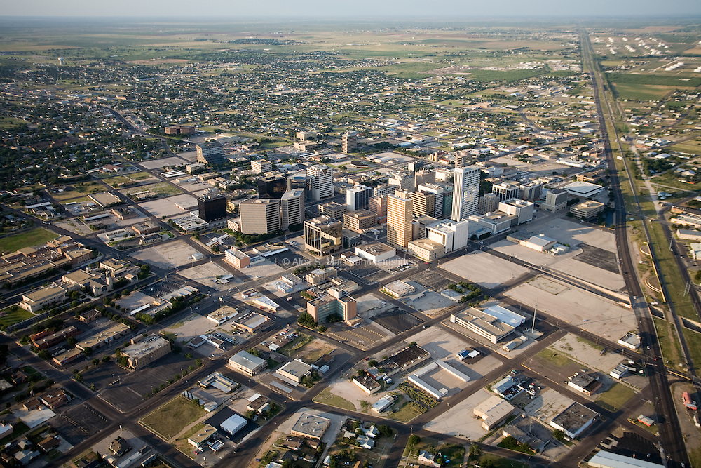 Parking lots surround the city of Midland, whose fortune is virtually pegged to the price of oil.  Midland's urban planners, however, claim the city still lacks adequate parking space.