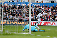 Tammy Abraham of Swansea city shoots past Watford goalkeeper Heurelho Gomes and scores his teams 1st goal to make it 1-1. Premier league match, Swansea city v Watford at the Liberty Stadium in Swansea, South Wales on Saturday 23rd September 2017.<br /> pic by  Andrew Orchard, Andrew Orchard sports photography.