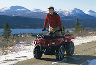 ATV rider looking over valley