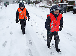 © under license to London News pictures. 30/11/2010. November snow scenes in Sydenham, Borough of Lewisham in south east London. Left, Eoin (8) and Connor (6) Treacy wearing high visibility vests walking to school in November snow. Photo credit should read: Paul Treacy/London News Pictures