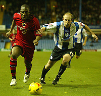Photo: Aidan Ellis.<br /> Sheffield Wednesday v Cardiff City. Coca Cola Championship. 25/11/2006.<br /> Cardiff's Malvin Kamara goes past wednesday's John Hills