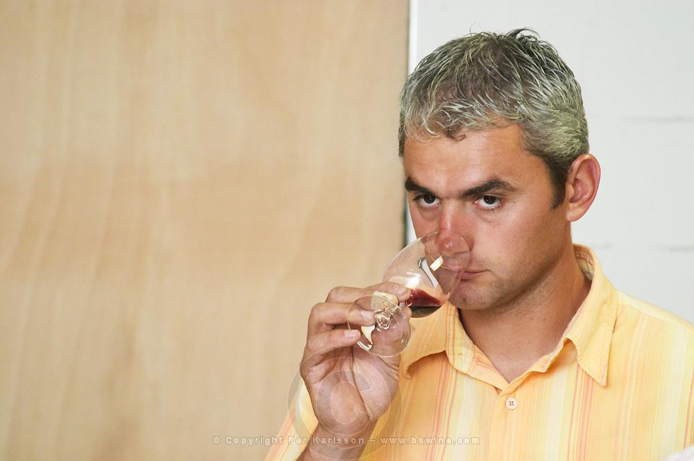 Eric Durand tasting a glass of wine.  Domaine Eric et Joel Joël Durand, Ardeche, Ardèche, France, Europe