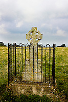 Celtic cross headstone on old grave in a field, Ireland. Architecture. Stock images.