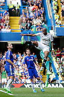 Swansea City's Andre Ayew battles for possession with Chelsea's Asmir Begovic<br /> <br /> Photographer Craig Mercer/CameraSport<br /> <br /> Football - Barclays Premiership - Chelsea v Swansea City - Saturday 8th August 2015 - Stamford Bridge - London<br /> <br /> © CameraSport - 43 Linden Ave. Countesthorpe. Leicester. England. LE8 5PG - Tel: +44 (0) 116 277 4147 - admin@camerasport.com - www.camerasport.com