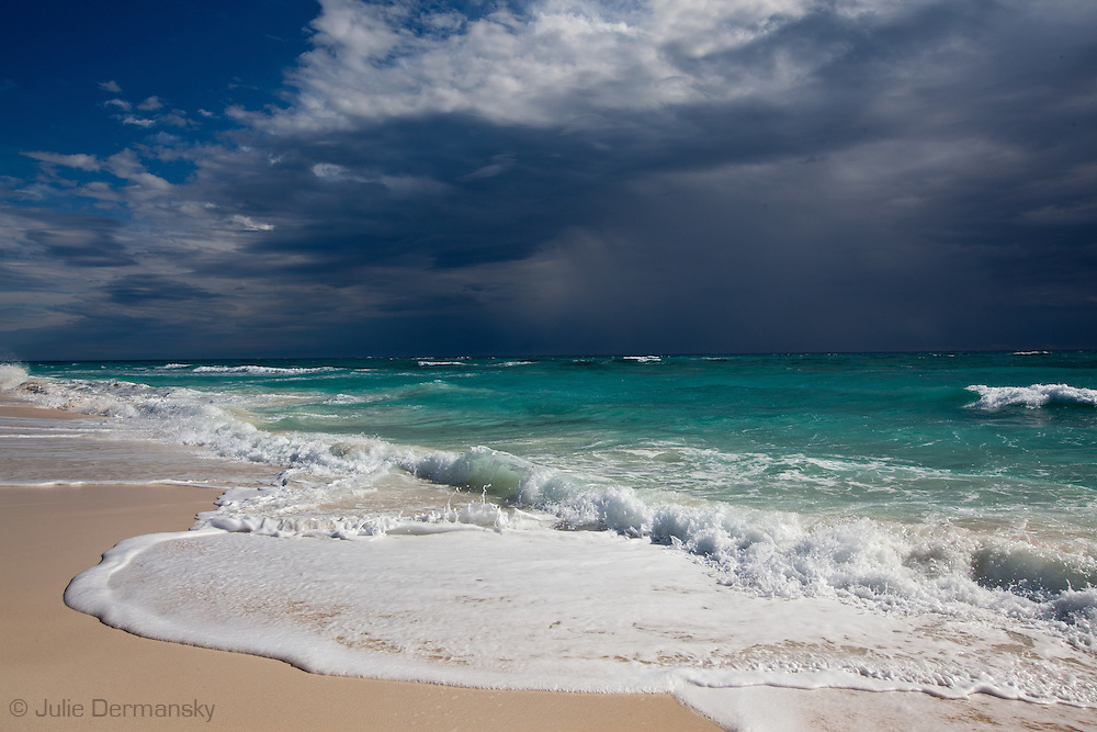 Storm Clouds over the Atlantic Ocean and beach on Elbow Cay one of the Abaco Islands in the Bahamas.