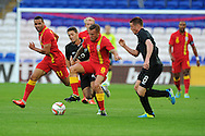 Craig Bellamy of Wales breaks away from Ireland's Wes Hoolahan. Friendly football international match, Wales v Republic of Ireland at the Cardiff city Stadium in Cardiff,  South Wales on Wed 14th August 2013. pic by Andrew Orchard,  Andrew Orchard sports photography,