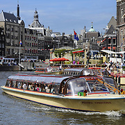 Sightseeing tours on canal boats in Amsterdam, Netherlands