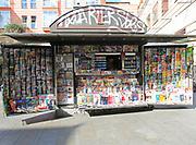 News stand display magazines newspapers sprayed with graffiti, Malasana, Madrid city centre, Spain