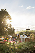 Cemetery with flowers ,The Church of Vilupulli, Chiloe.Chile.