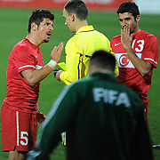 Referee's Sergii BOIKO (C) and Turkey's Emre BELOZOGLU (L) during their International friendly soccer match Turkey between South Korean at the Avni Aker stadium in Trabzon, Turkey on Wednesday 09 February 2011. Photo by TURKPIX