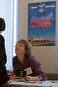 Rechitsy, Russia, 02/03/2008..An election officer checks documents as Russians vote during the Presidential election that President Vladimir Putin's chosen heir Deputy Prime Minister Dmitry Medvedev is expected to win easily in the first round.